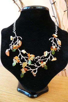 Autumn leaves. Semi-precious stones and Czech glass leaves adorn silver plated branches.