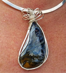 Stunning, large, handcut pietersite, wrapped in sterling silver.