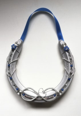 An infinity loop with a heart,bright blue beads and crystals