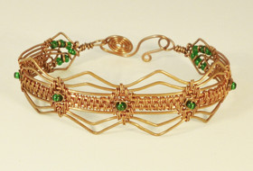 Bright copper woven cuff bracelet with glass beads