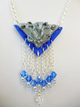 An Art Deco style piece in polymer clay with Swarovski crystals.