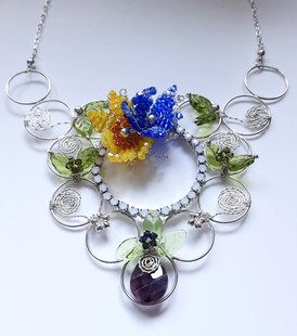 Circles of Spring in sterling silver with Swarovski flowers, an amethyst and Czech glass leaves.