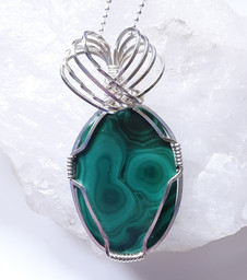 This beautiful malachite is wrapped in sterling silver.