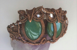 Woven cuff beacelet with a pair of owls. Antiqued copper.