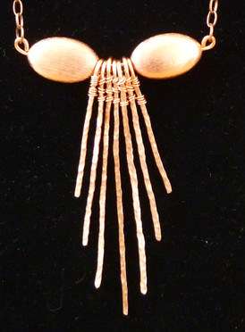 Copper beads and textured copper wire strands.