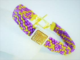 Purple and gold woven bracelet in with a gold rhinestone embelishment