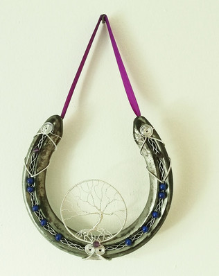 A tree of life with amethysts and navy blue rounds