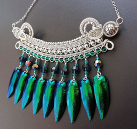 Sterling silver, Austrian crystals and the hard, protective wing casings of the Sternocera aequisignata beetle.