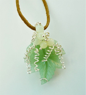 A large aventurine leaf in silver plated wire with Chinese jade beads.
