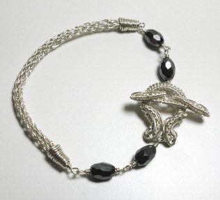 Silver plated wire work bracelet and clasp with black crystals