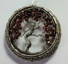 A garnet tree of life. A very structural piece in woven and antiqued sterling silver.