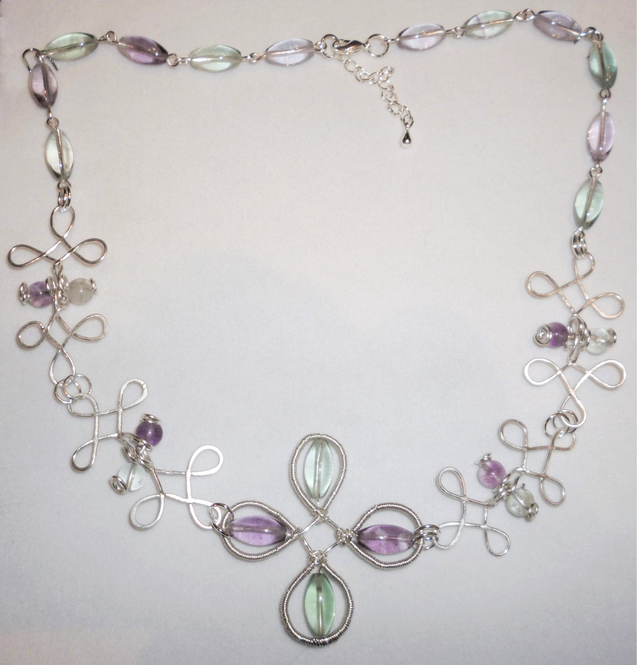 Fluorite in delicate purple and green adorn this Celtic design necklace.