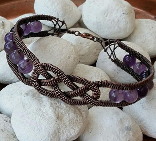Copper wire woven in a Celtic design, with amethyst beads and a dark antiqued finish.