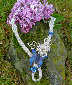 The butterfly on this inticately woven necklace was commissioned for this statement piece.