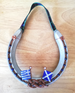 Made for a friend in Greece. Copper with blue agates and beaded flags of Greece and Scotland.