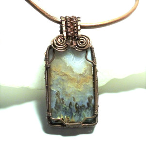 Step into a beautiful scene of hills and trees as depicted in this picture agate.