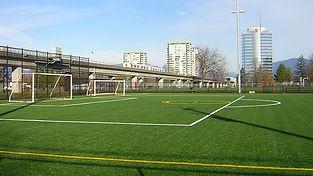 boy-playing-soccer-ball-during-daytime.j