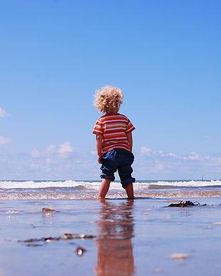 Boy Facing Ocean