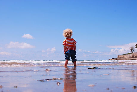 Boy Facing Ocean