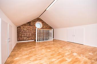 Loft Room Conversion with Circular Windo