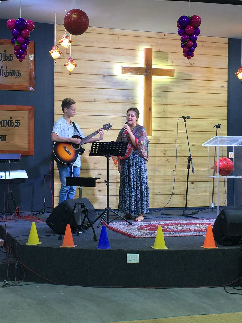 Claire & Elijah leading worship