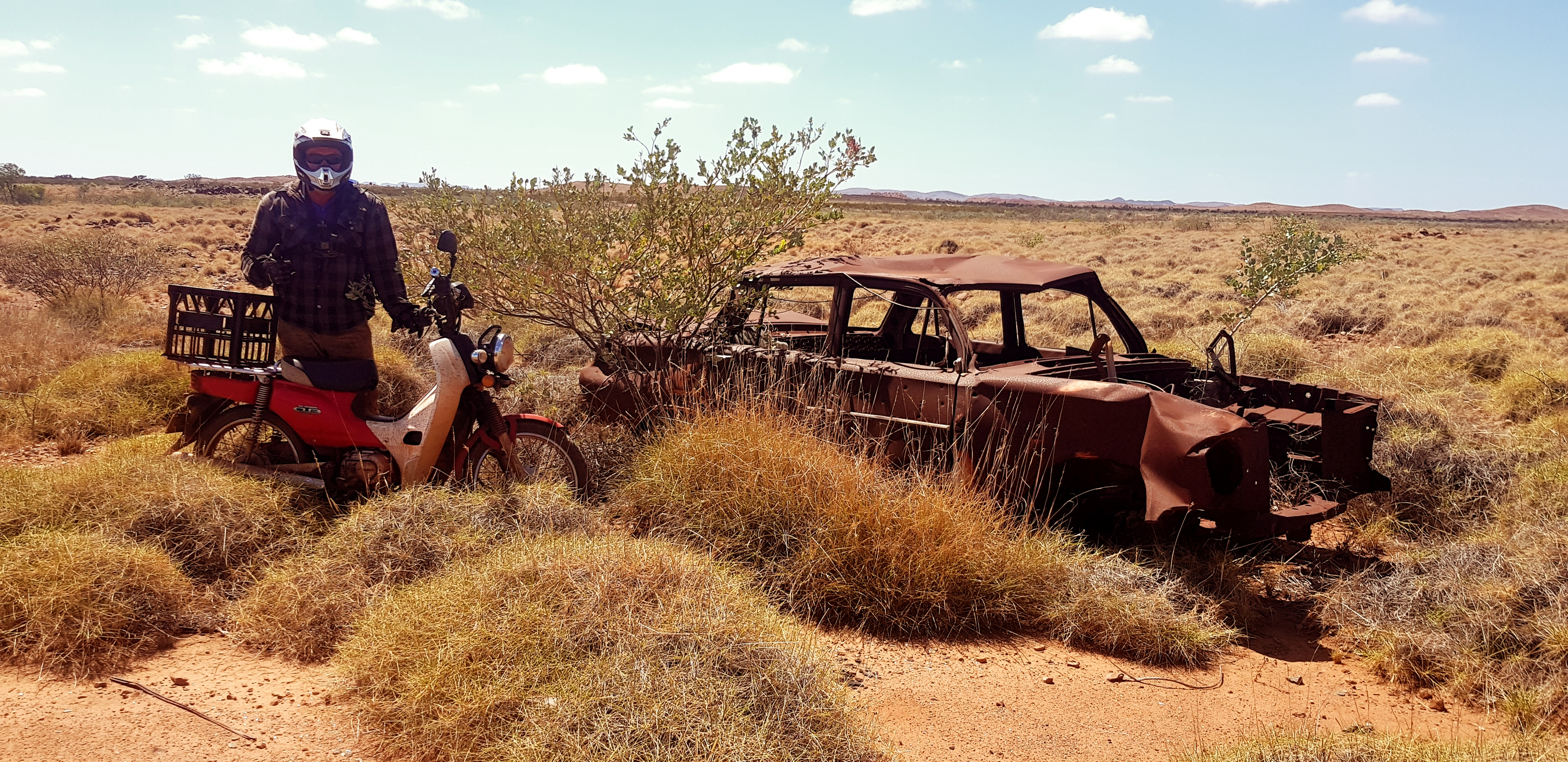 a wreck and a postie in the pilbara