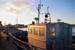 Trawler at sunset