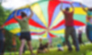 Rise Campers playing with a parachute