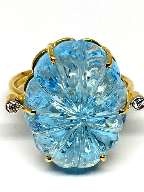 Large blue topaz carved 18 karat gold ring with diamond accents