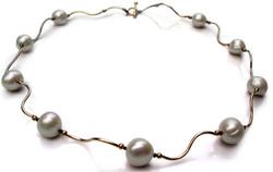 Pearl and black diamond 14 karat golden waves necklace