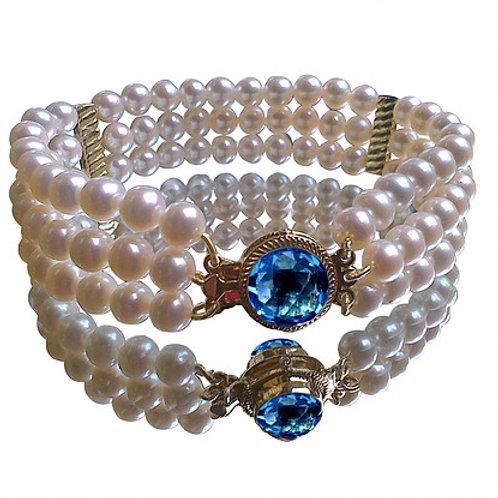 Triple strand pearl diamond bracelet with blue topaz clasp