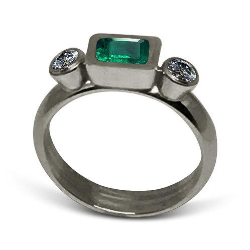 Emerald diamond bezel set platinum ring