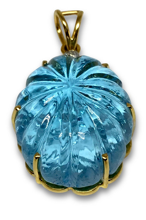 Large blue topaz carved pendant 18 karat gold with diamond accents