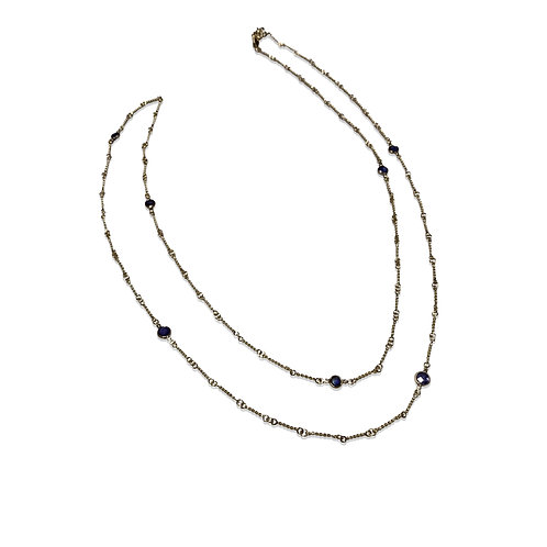 Long 18 karat gold hand-made chain with blue topaz stations