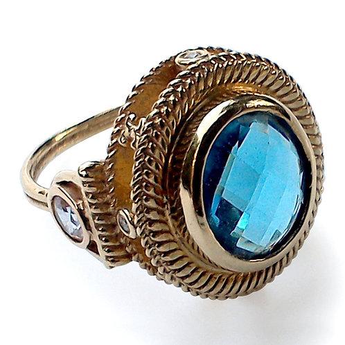 Blue topaz diamond and white sapphire 18 karat gold ring