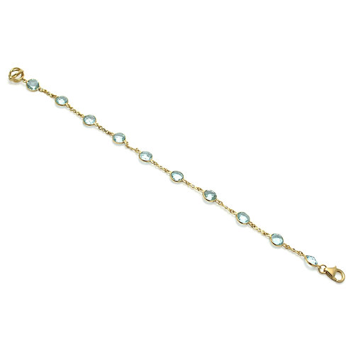 Blue topaz and diamond 18 karat gold line bracelet