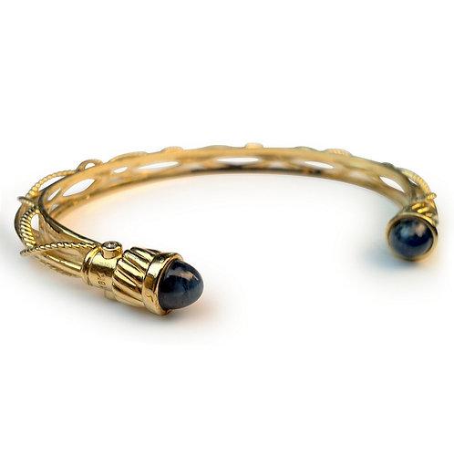 Diamond 18 karat gold bangle bracelet with end gems