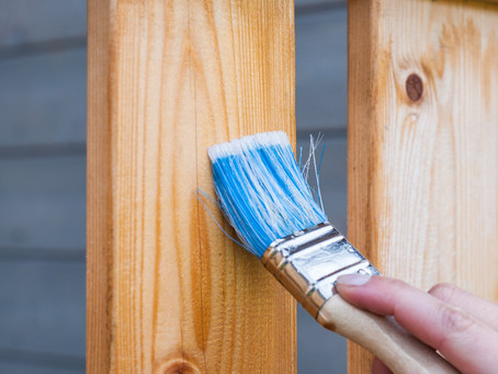Does paint prevent damage on a fence?