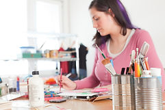 woman-painting-with-varied-supplies.jpg