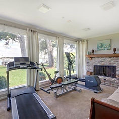 a fitness room with exercise equipment