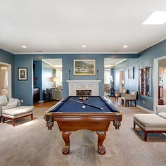 a den with  pool table