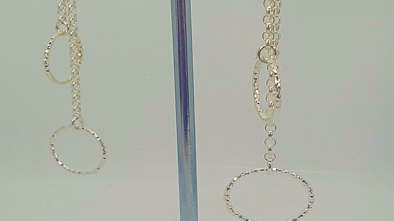 Sterling silver chain earring with decorative rings