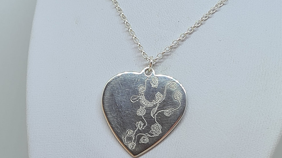 Engraved sterling silver heart pendant