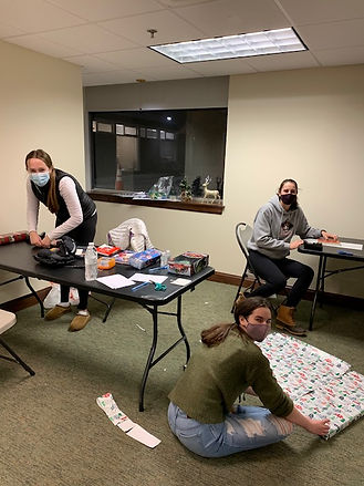 WHS students wrapping gifts.jpg