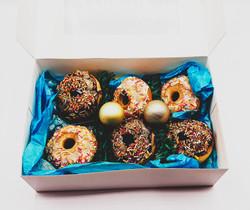 Box of festive donuts