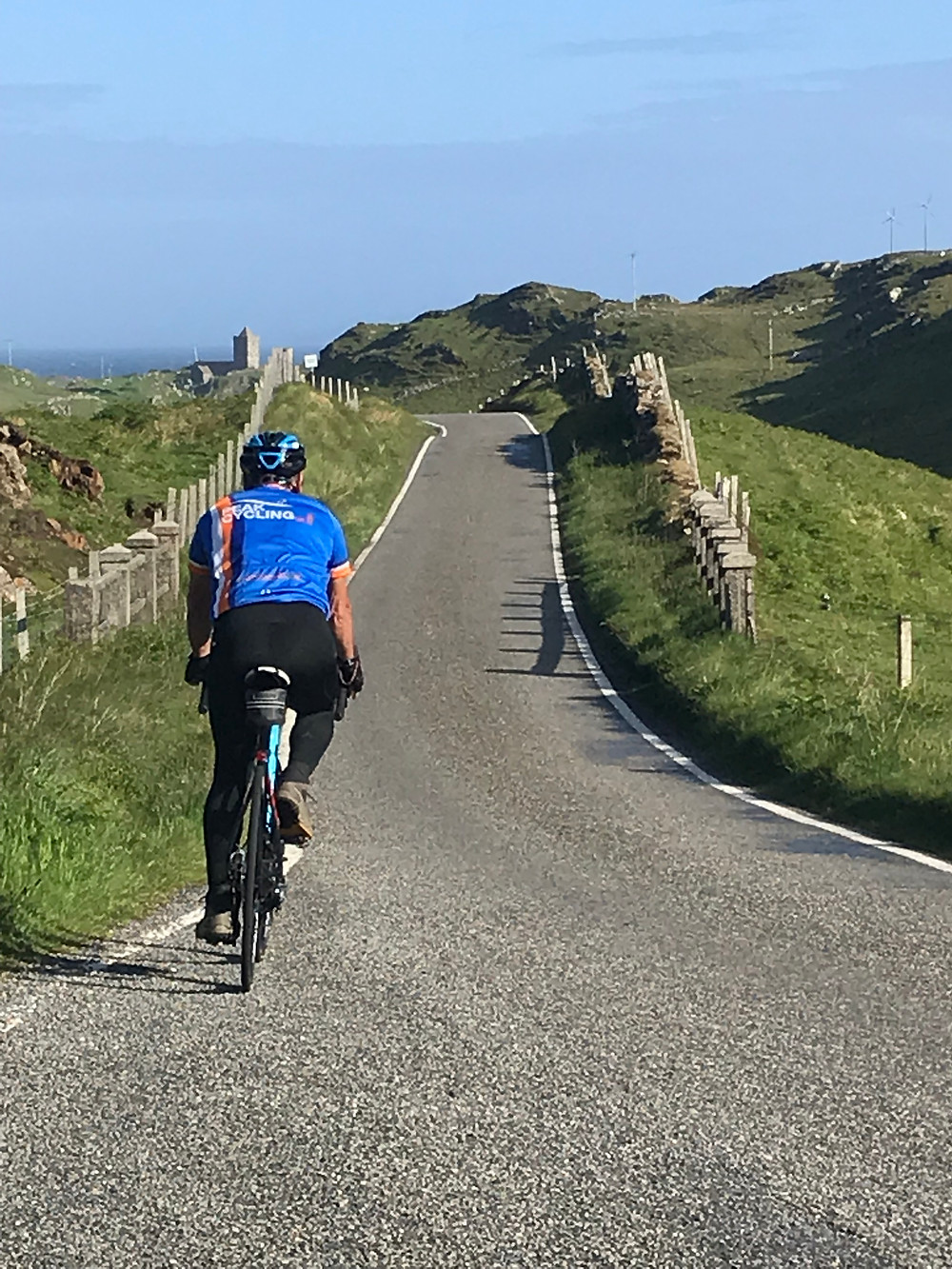 Fred riding on hebridean road