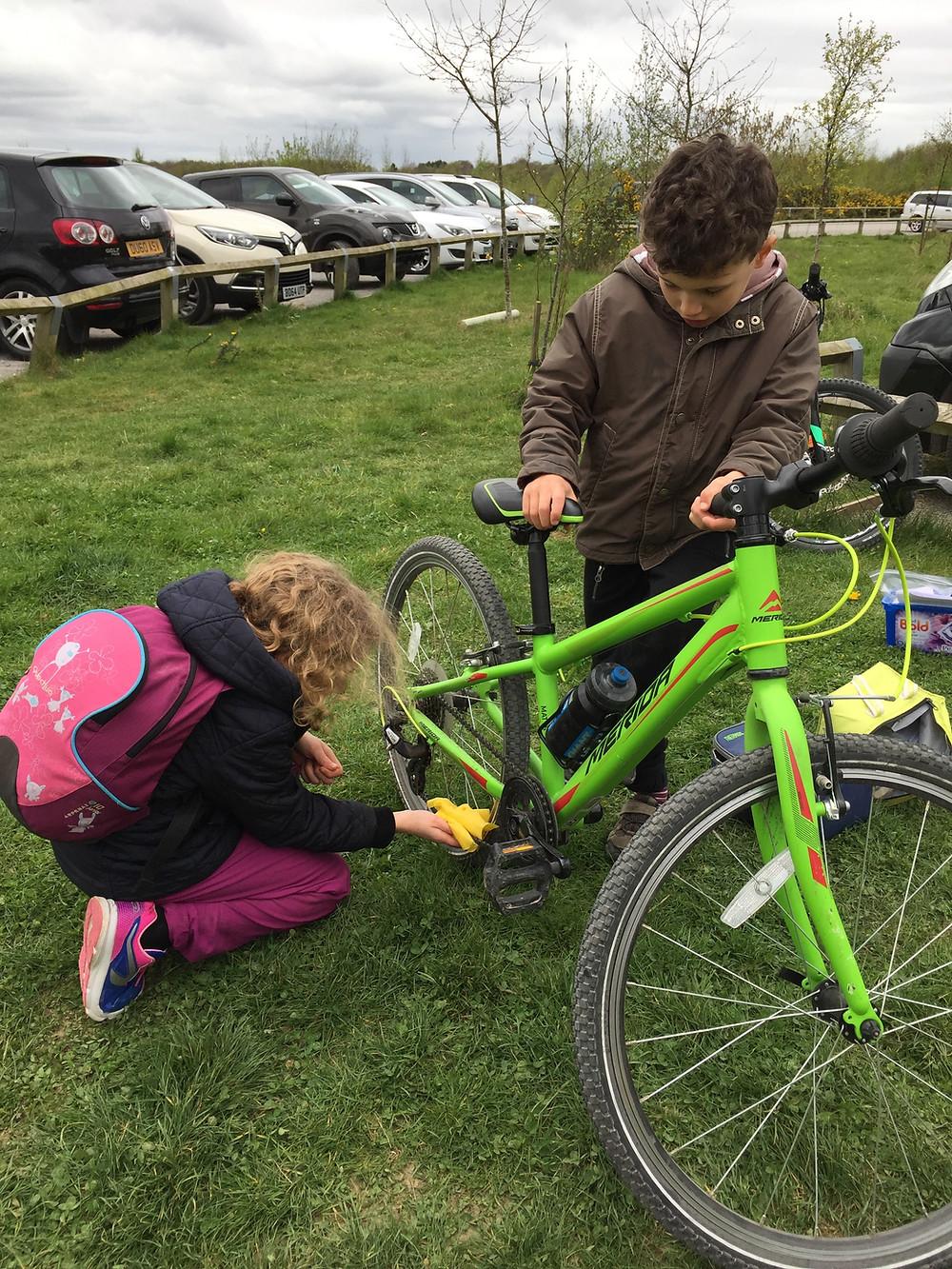 Kids cleaning bikes (yep, really!)