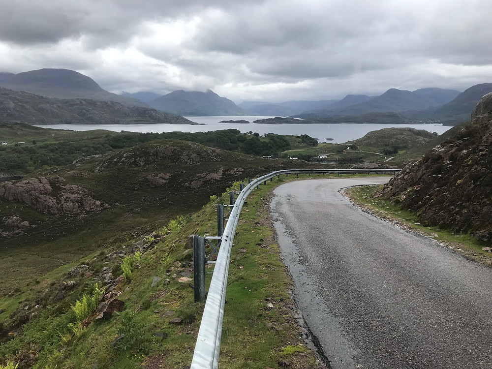 Descending a quiet road to the loch side