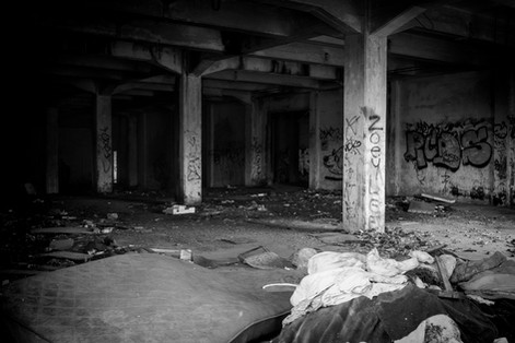 Abandoned building with graffiti and trash