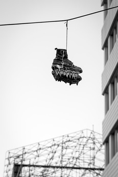 Boots on a power line